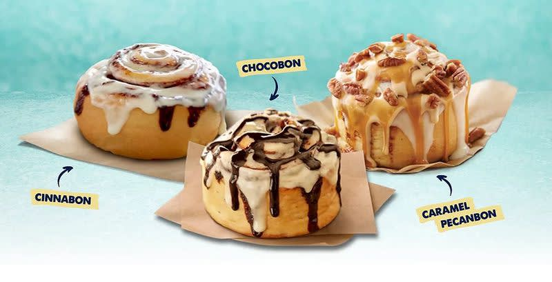 A photo of Cinnabon buns on display in the store