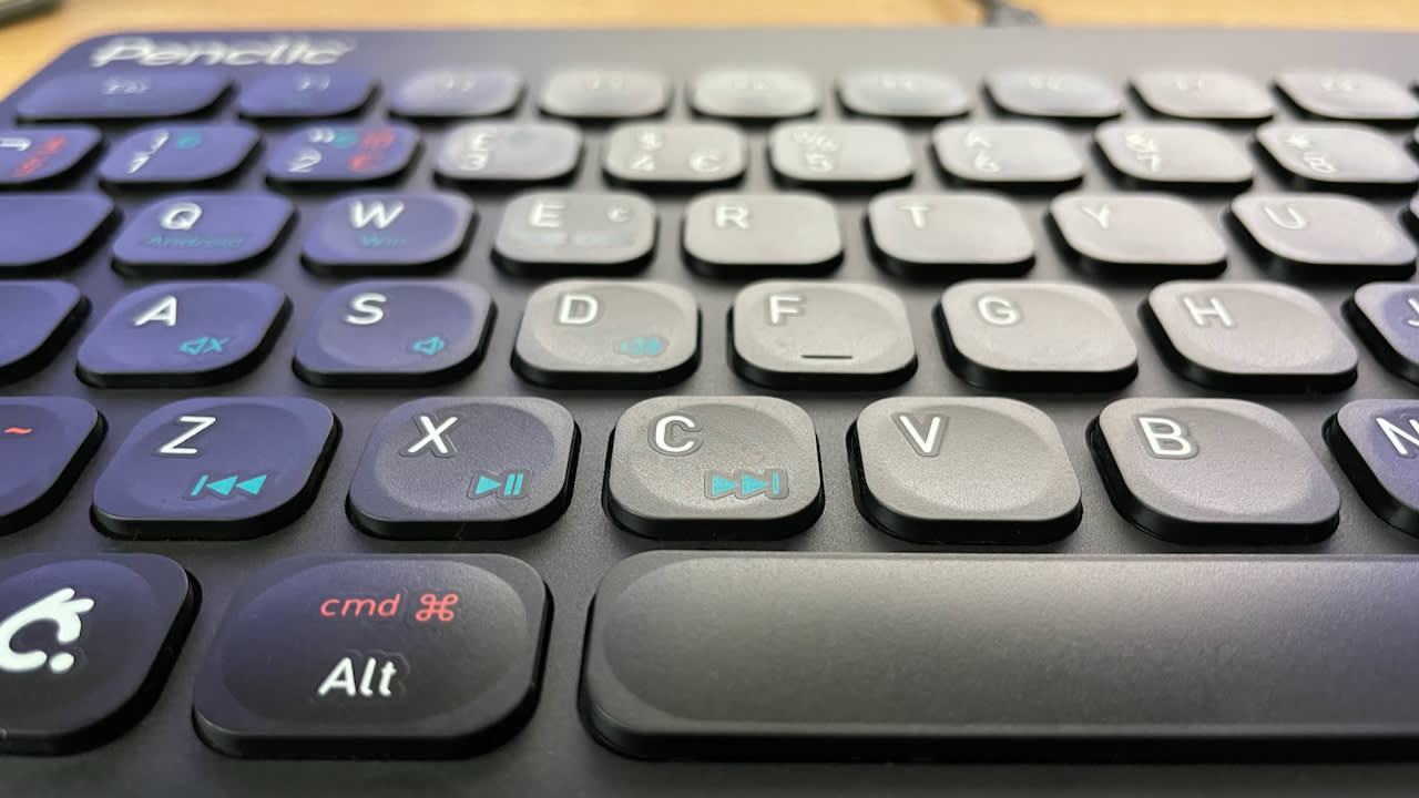 A close up of the keys on the keyboard, showing the indented and raise key surfaces