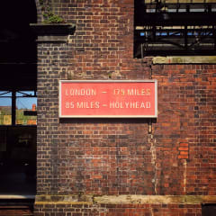 """Sign that reads """"London - 179 miles, Holyhead 85 miles"""""""