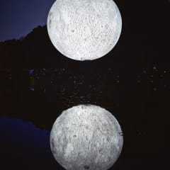 A large illuminated model of the moon hangs over the lake in Brighton's Queen Park.