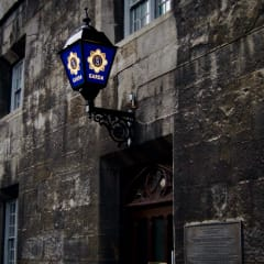 Blue police lamp above an entrance to a police station.