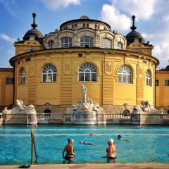Swimmers in victorian outside thermal baths.