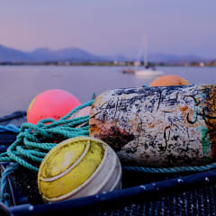 Bright fishing floats and nets as the sun sets over Roundstone.