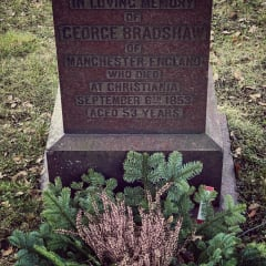 """Headstone reads: """"In loving memory of George Bradshaw of Manchester, England who died at Christiania September 6th 1853 aged 53 years""""."""