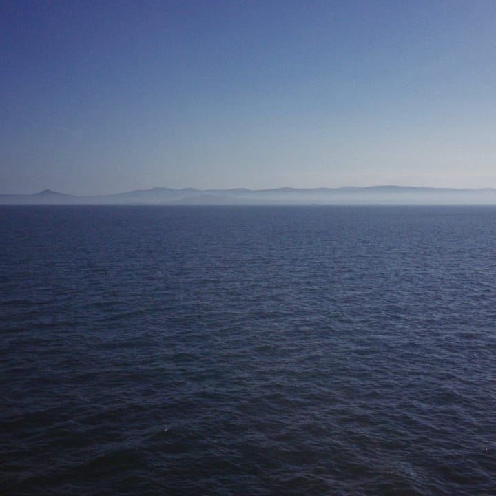 Irish coastline on the horizon