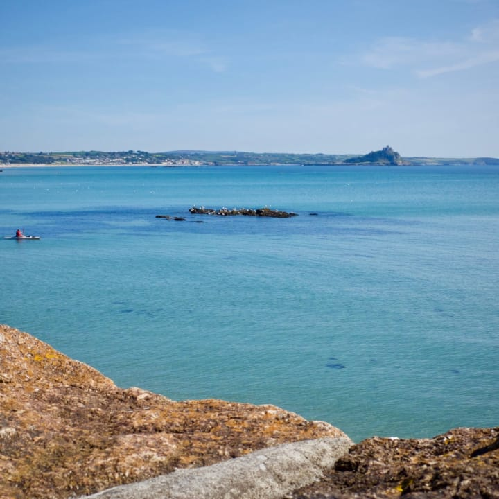 Looking over a turquoise blue sea towards St. Michael's Mount