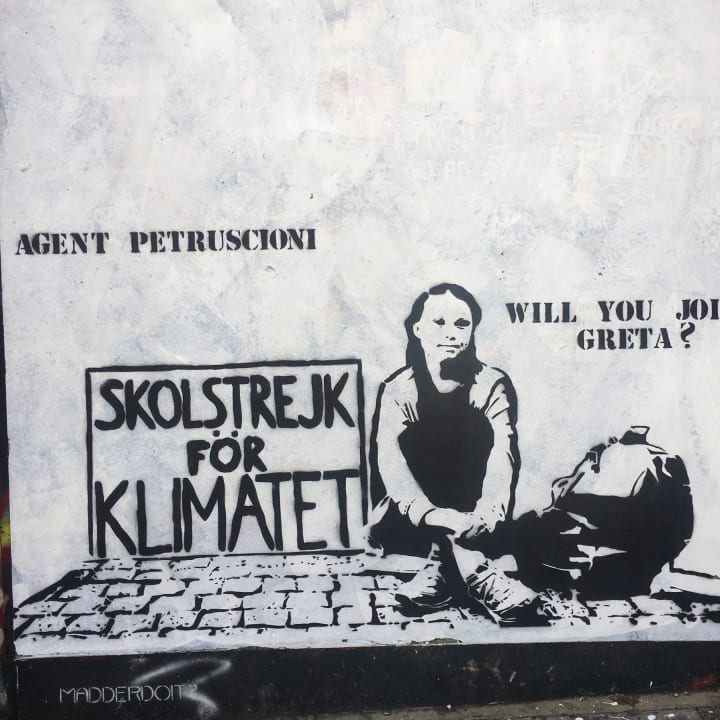Graffiti of Greta Thunberg with the caption 'Will you join Greta?'