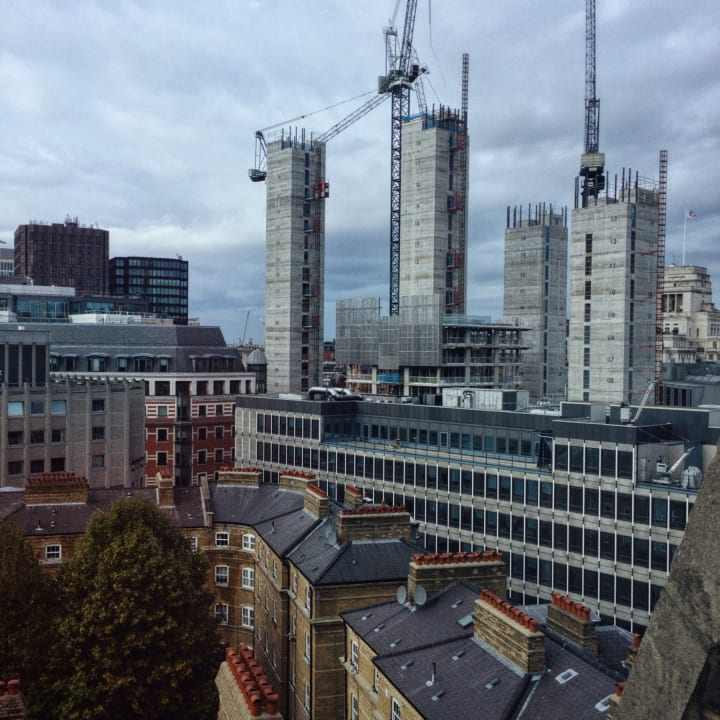 View of rooftops and building construction in Westminster from the top floor of the Department of Education.