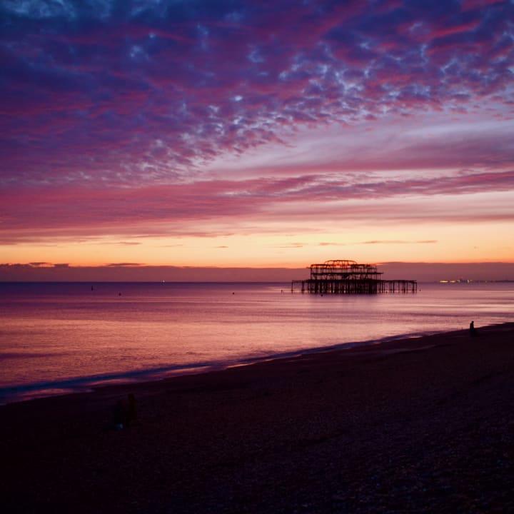 Sunset over Brighton's derilict West Pier.