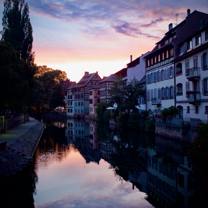 Sun setting over the river aside the La Petite France district of Strasbourg.