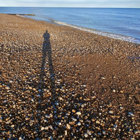 My shadow on Cooden Beach.