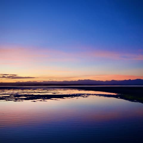 Reflected sunset over Tahunanui beach.