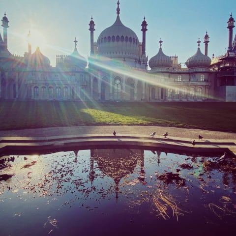 Brighton Pavilion partially obscured by a ray of sunlight.