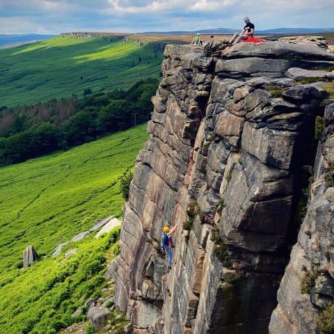 People rock climbing.