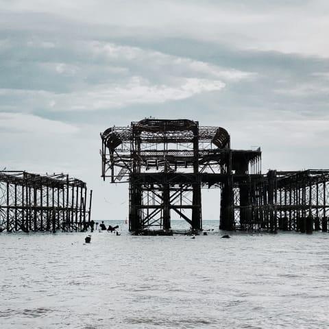 Directly facing Brighton's derelict West Pier.