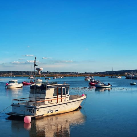 Fishing boats anchored in Keyhaven harbour.