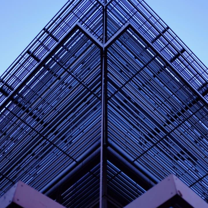 Symmetrical metal work on one corner of Dublin City Hall.