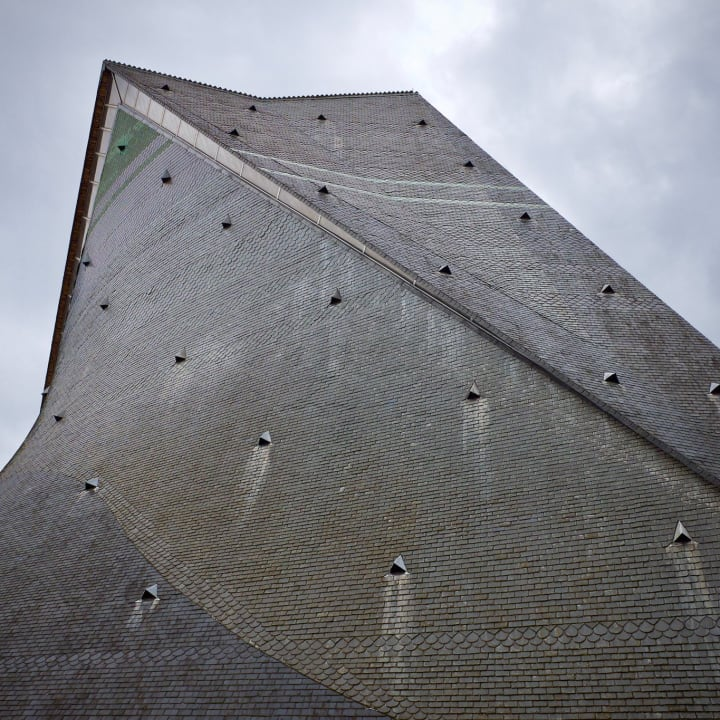 Distinctive angular roof of the Church of St Joan of Arc.