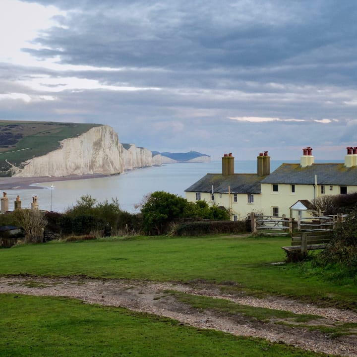 Coastguard Cottages with Seven Sisters in the background.