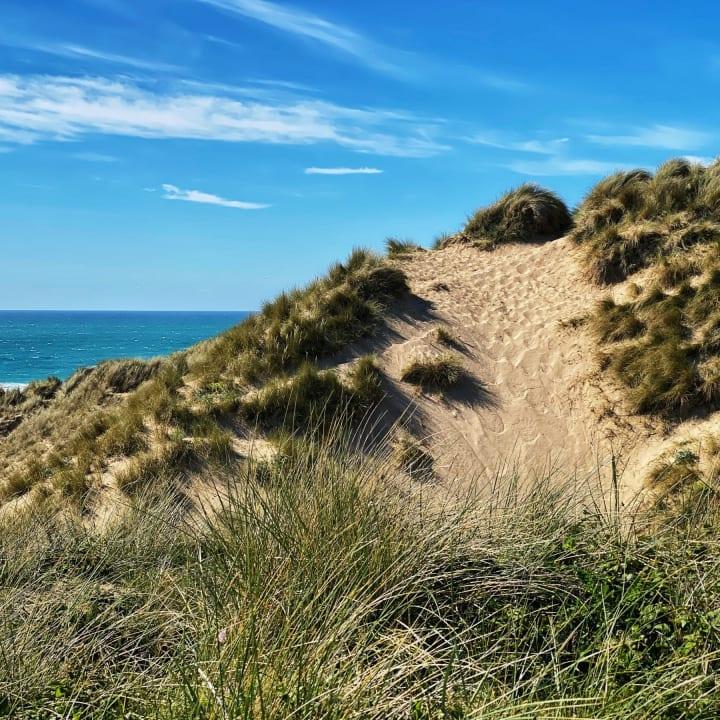 Sand dunes near Holywell Beach.