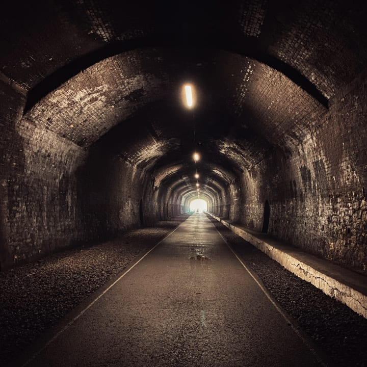 Inside a disused railway tunnel.