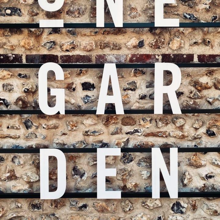 'One Garden Brighton' signage.