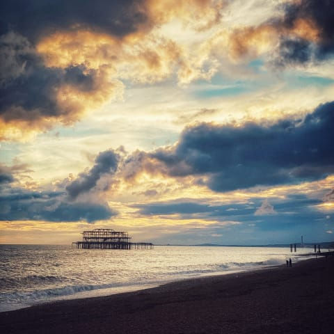 Dramatic sunset over Brighton's West Pier.