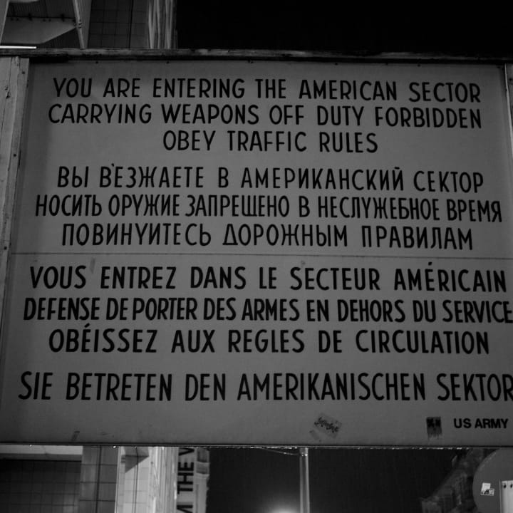 """Sign that starts by sating """"You are entering the American sector""""."""