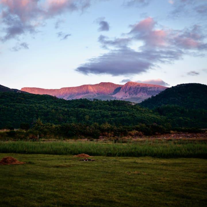 Sun setting over the Cader Idris mountain range.