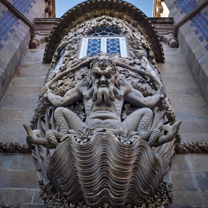 A goulish sea monster (strone relief) below a protruding window.