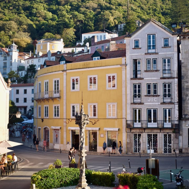 The historic center of Sintra with Moors Castle on hilltop above.