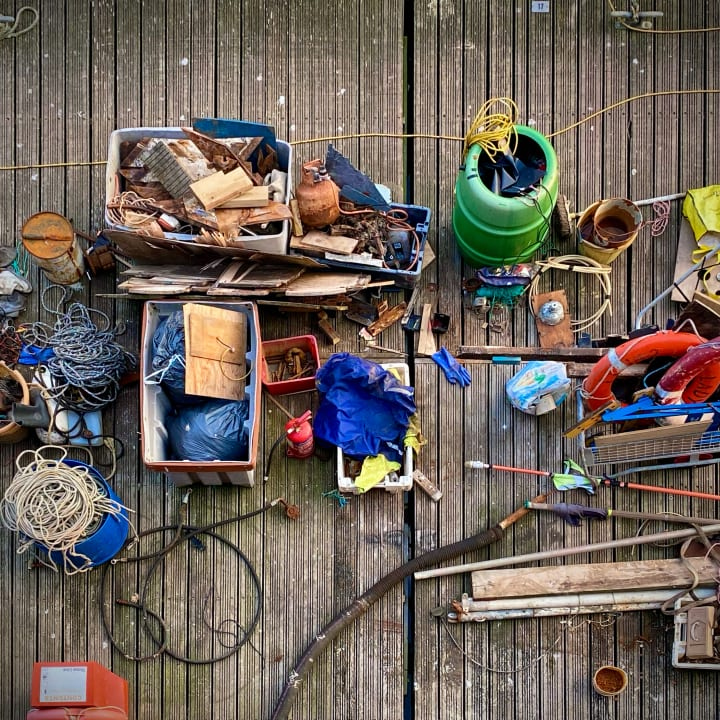 Fishing tackle and other scattred sailing equipment.
