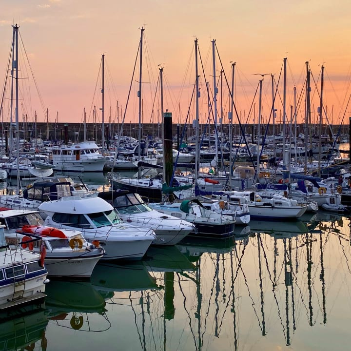 Boats in Brighton Marina as the sun sets.