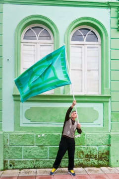 Resident waving a green flag