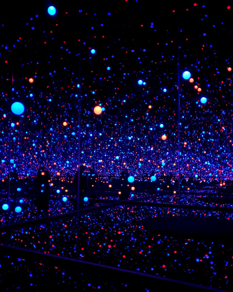 Dark room with small bright red and blue lights.