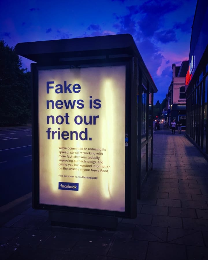 "Advert on a bus stop that reads ""Fake news is not our friend"""
