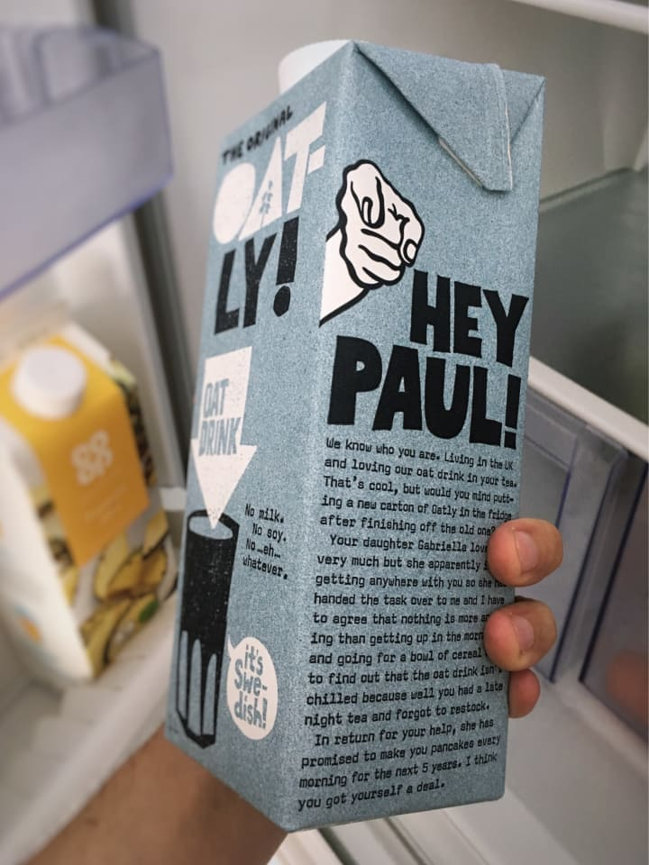 "Carton of Oatly, the side of which reads ""Hey Paul!"""