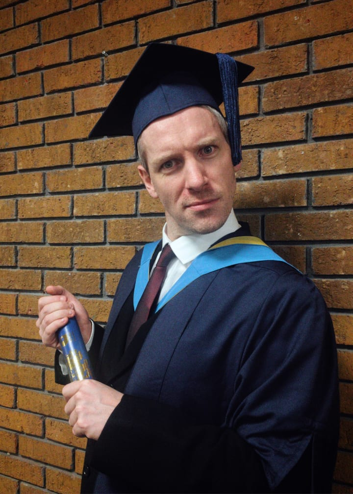 My brother, in his graduation robes.