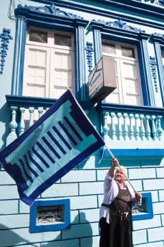 Resident waving a blue flag