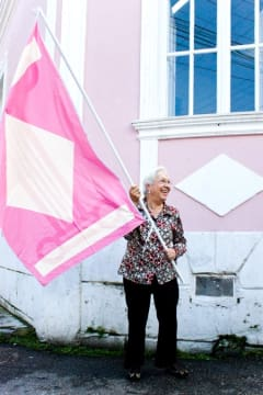 Resident waving a pink flag
