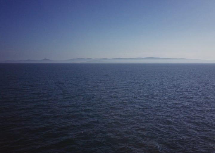 Irish coastline on the horizon.