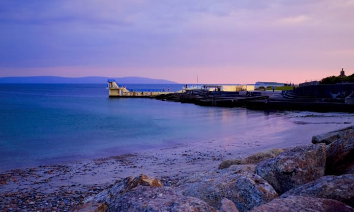 Dusk creates a pink light over the Blackrock Diving Tower in Salthill.
