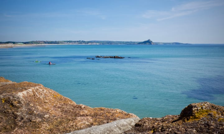 Looking over a turquoise blue sea towards St. Michael's Mount.