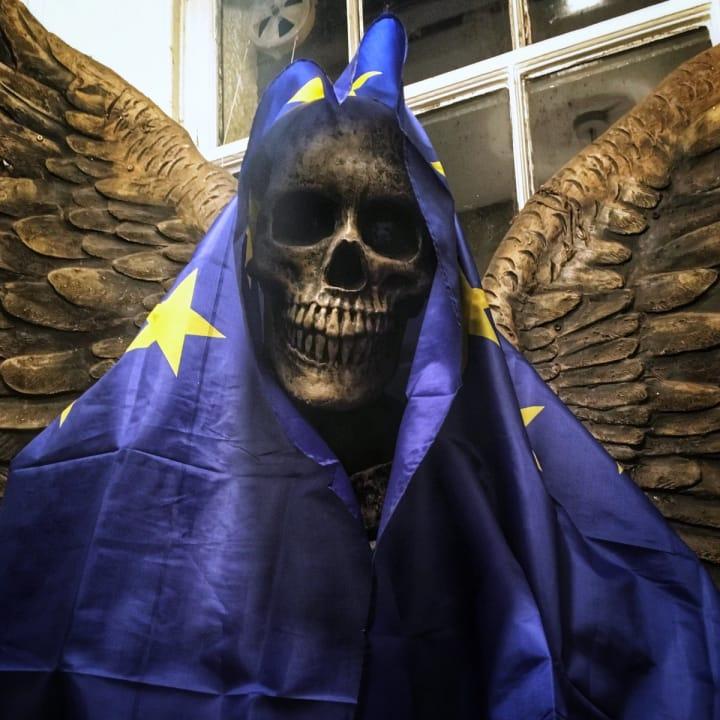Skeleton wearing the European flag.