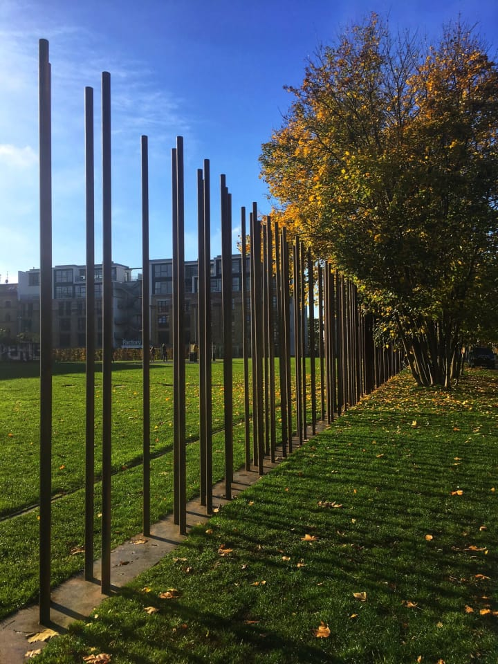 Steel poles mark the former path of the Berlin Wall.