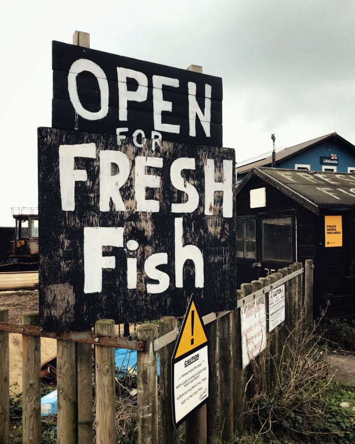 "Sign that reads ""Open for Fresh Fish""."