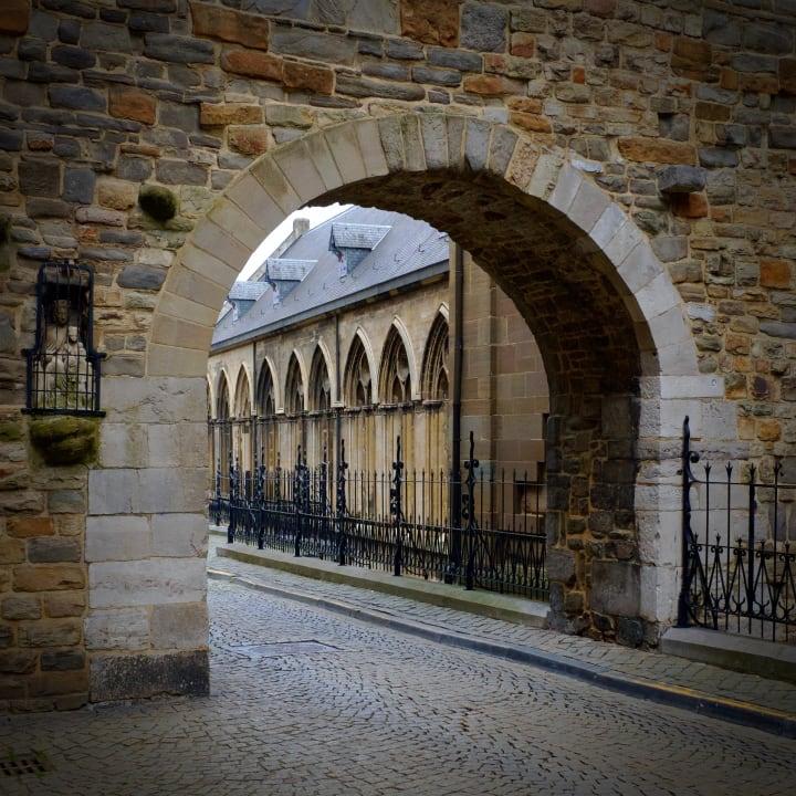 View through a stone arch, behind the Basilica of Saint Servatius.