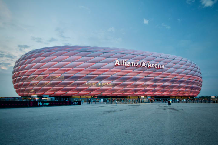 Allianz Arena lit up in red.