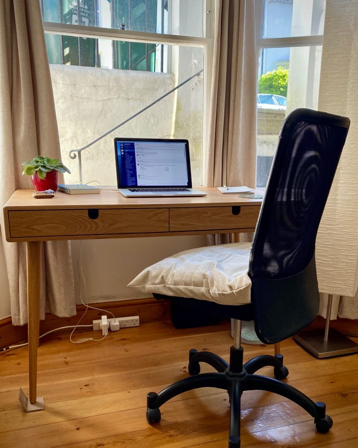 Desk and chair, positioned next to the window in my living room.