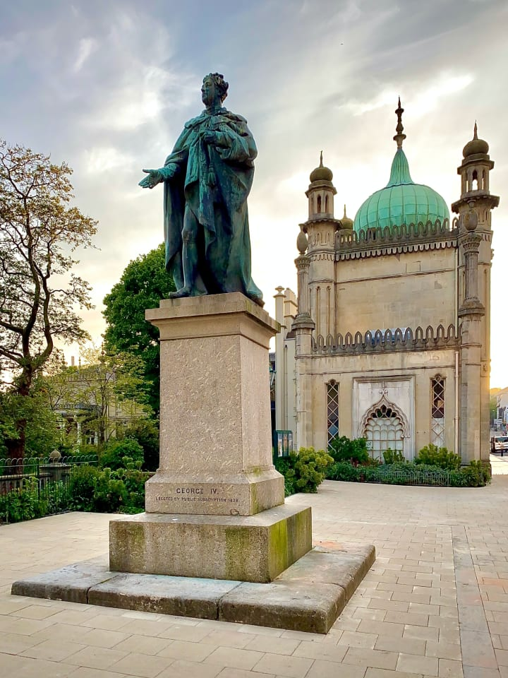 Statue of George IV outside Brighton's Pavilion Gardens.
